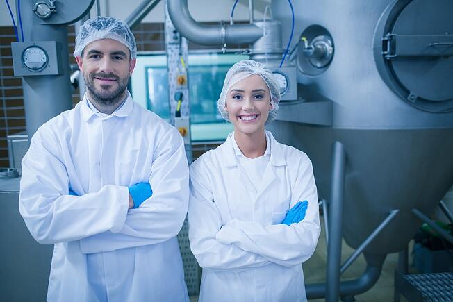 Food technicians smiling at camera in a food processing plant.jpeg