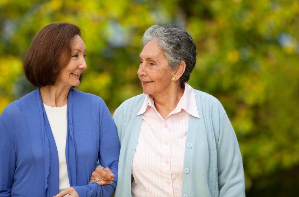 Portrait of an elder mother and daughter walking outdoors.jpeg
