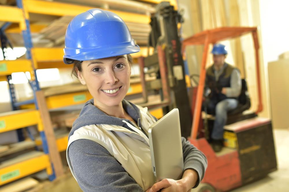 Smiling woman working in warehouse.jpeg