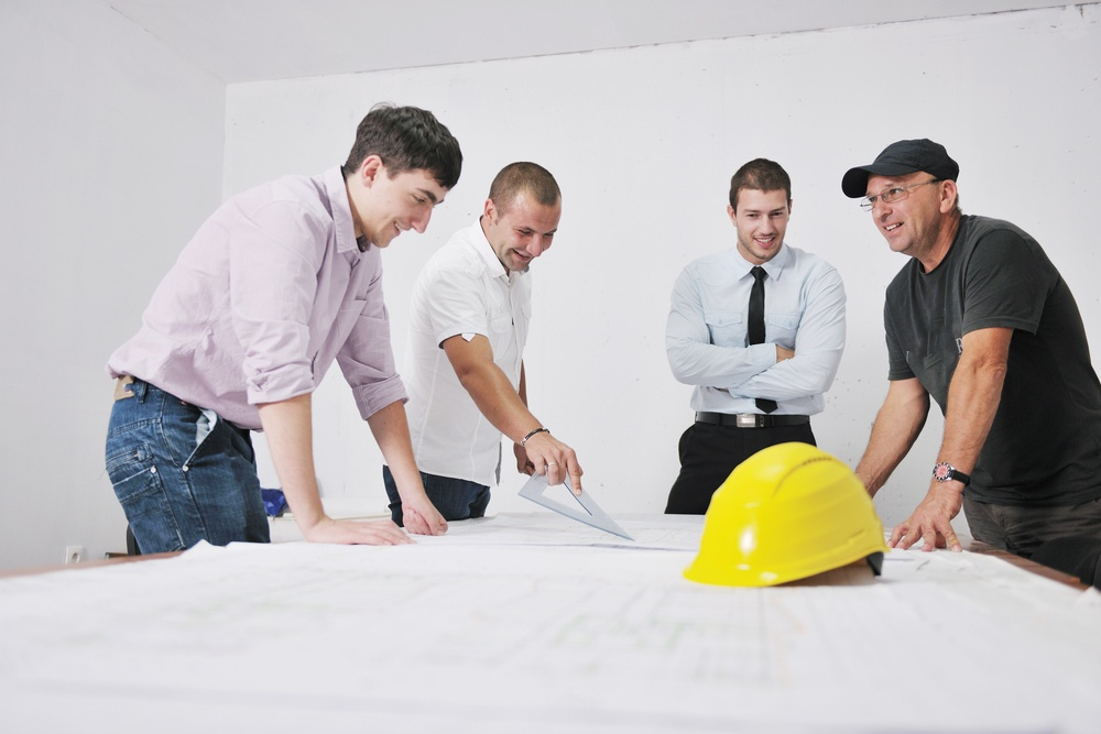 Team of business people in group, architect and engineer  on construction site check documents and business workflow on new building-1.jpeg