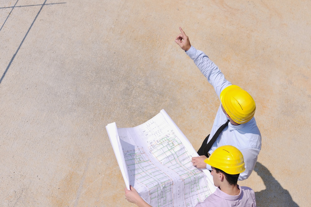 Team of business people in group, architect and engineer  on construction site check documents and business workflow on new building.jpeg